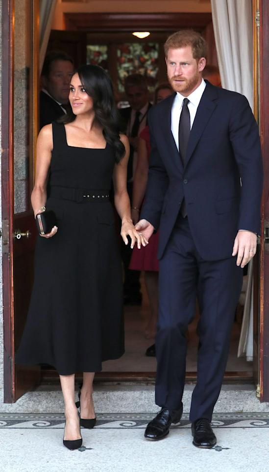 """<p>The Duchess wore a gorgeous <a rel=""""nofollow"""" href=""""https://www.townandcountrymag.com/society/tradition/a22107199/meghan-markle-black-dress-emilia-wickstead-dublin-royal-visit-2018/"""">little black dress by Emilia Wickstead</a> for the occasion. </p>"""