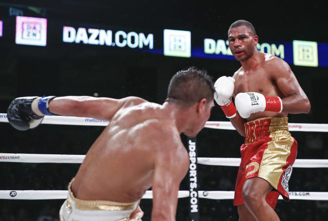 Thomas Dulorme, right, knocks down Jessie Vargas during a boxing bout Saturday, Oct. 6, 2018, in Chicago. (AP Photo/Kamil Krzaczynski)