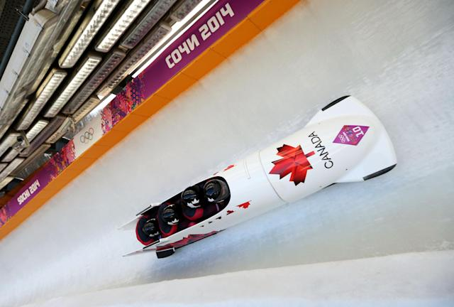 SOCHI, RUSSIA - FEBRUARY 23: Pilot Justin Kripps, Jesse Lumsden, Cody Sorensen and Ben Coakwell of Canada team 3 make a run during the Men's Four Man Bobsleigh on day 16 of the Sochi 2014 Winter Olympics at Sliding Center Sanki on February 23, 2014 in Sochi, Russia. (Photo by Mike Ehrmann/Getty Images)