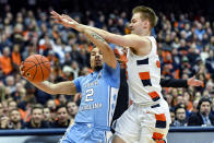North Carolina guard Cole Anthony (2) is defended by Syracuse guard Buddy Boeheim during the first half of an NCAA college basketball game in Syracuse, N.Y., Saturday, Feb. 29, 2020. (AP Photo/Adrian Kraus)