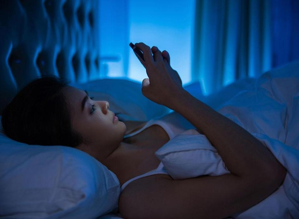 using phone in bed