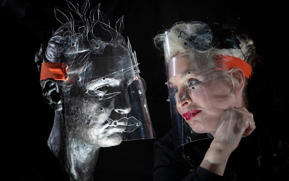 Artist Boo Paterson, from Fife, models some of the bespoke protective face shields she was inspired to create during lockdown when she saw that the big fashion houses in Paris were re-opening their stores with staff wearing medical PPE - Jane Barlow/PA