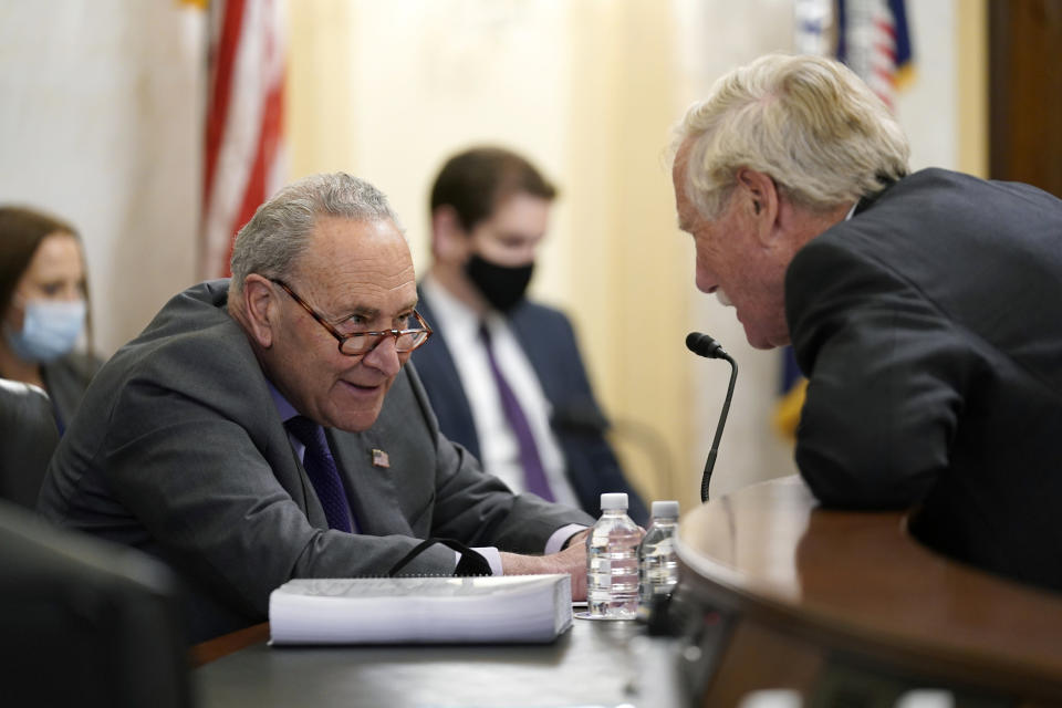 Senate Majority Leader Chuck Schumer of N.Y., and Sen. Angus King, I-Maine, speak before a Senate Rules Committee hearing at the Capitol in Washington, Tuesday, May 11, 2021. (AP Photo/J. Scott Applewhite)