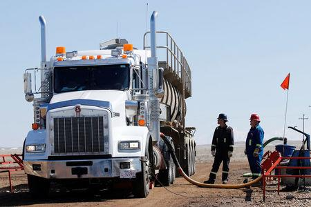 A tanker truck used to haul oil products operates at a facility near Brooks