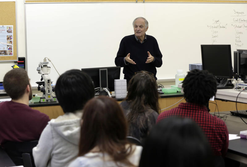 In this Friday, April 26, 2013 photo, actor Alan Alda addresses a Communicating Science class on the campus of Stony Brook University, on New York's Long Island. The film and television star is trying to encourage scientists of all disciplines to ditch the jargon and speak in plain English. (AP Photo/Richard Drew)
