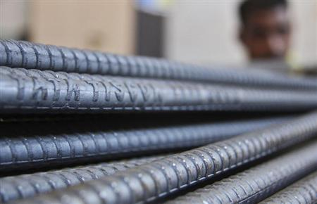A labourer works at a Tata steel iron godown in the northern Indian city of Chandigarh