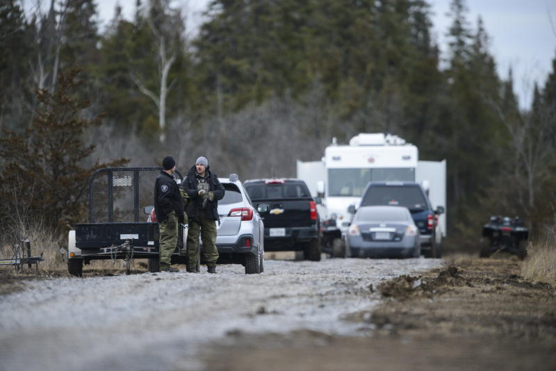 Personnel work at the site of a fatal plane crash in Kingston, Ontario, on Thursday, Nov. 28, 2019., as police and the Transportation Safety Board continue to investigate the incident. (Sean Kilpatrick/The Canadian Press via AP)