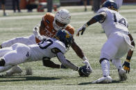 West Virginia's Alec Sinkfield (20) dives for a ball he fumbled against Texas' Roschon Johnson (2) during the first half of an NCAA college football game in Austin, Texas, Saturday, Nov. 7, 2020. West Virginia recovered the ball. (AP Photo/Chuck Burton)