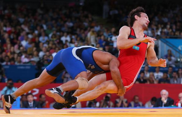 LONDON, ENGLAND - AUGUST 12:  Sushil Kumar of India in action against Akzhurek Tanatarov of Kazakhstan during the Men's Freestyle Wrestling 66kg semi final match on Day 16 of the London 2012 Olympic Games  at ExCeL on August 12, 2012 in London, England.  (Photo by Ryan Pierse/Getty Images)