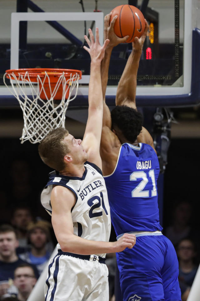 Seton Hall center Ike Obiagu (21) gets a dunk over Butler center Derrik Smits (21) in the first half of an NCAA college basketball game in Indianapolis, Wednesday, Jan. 15, 2020. (AP Photo/Michael Conroy)