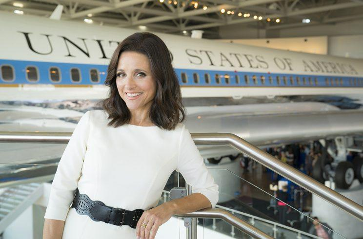Julia Louis-Dreyfus as Selina Meyer stands in front of a plane in a museum.