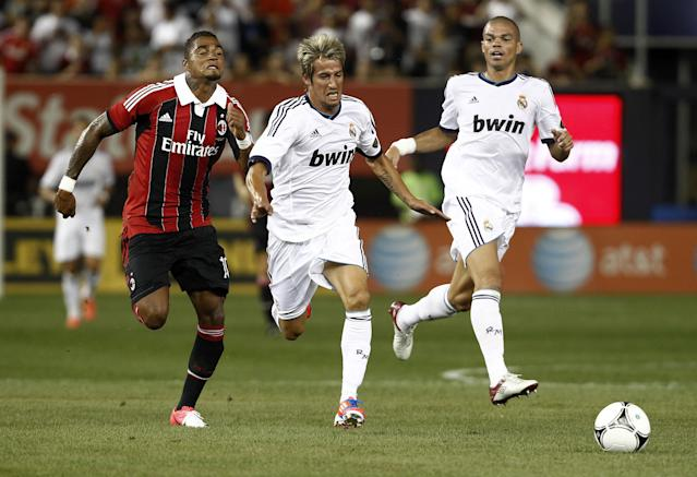 NEW YORK - AUGUST 08: Fabio Coentrao #15 of Real Madrid and Kevin-Prince Boateng #10 of A.C. Milan fight for the ball during their match at Yankee Stadium on August 8, 2012 in New York City. (Photo by Jeff Zelevansky/Getty Images)