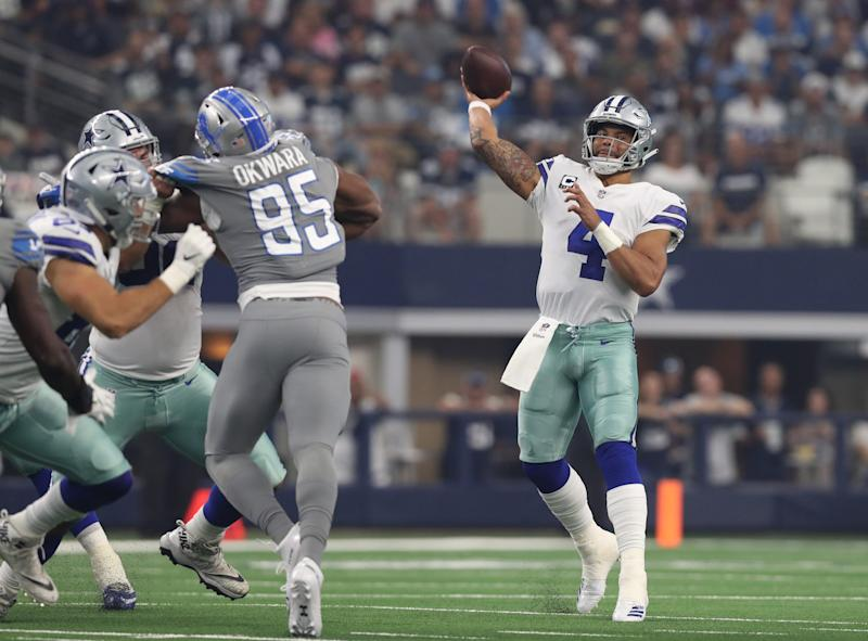 Cowboys quarterback Dak Prescott throws against the Lions in the first quarter in Arlington, Texas, Sunday, Sept. 30, 2018.