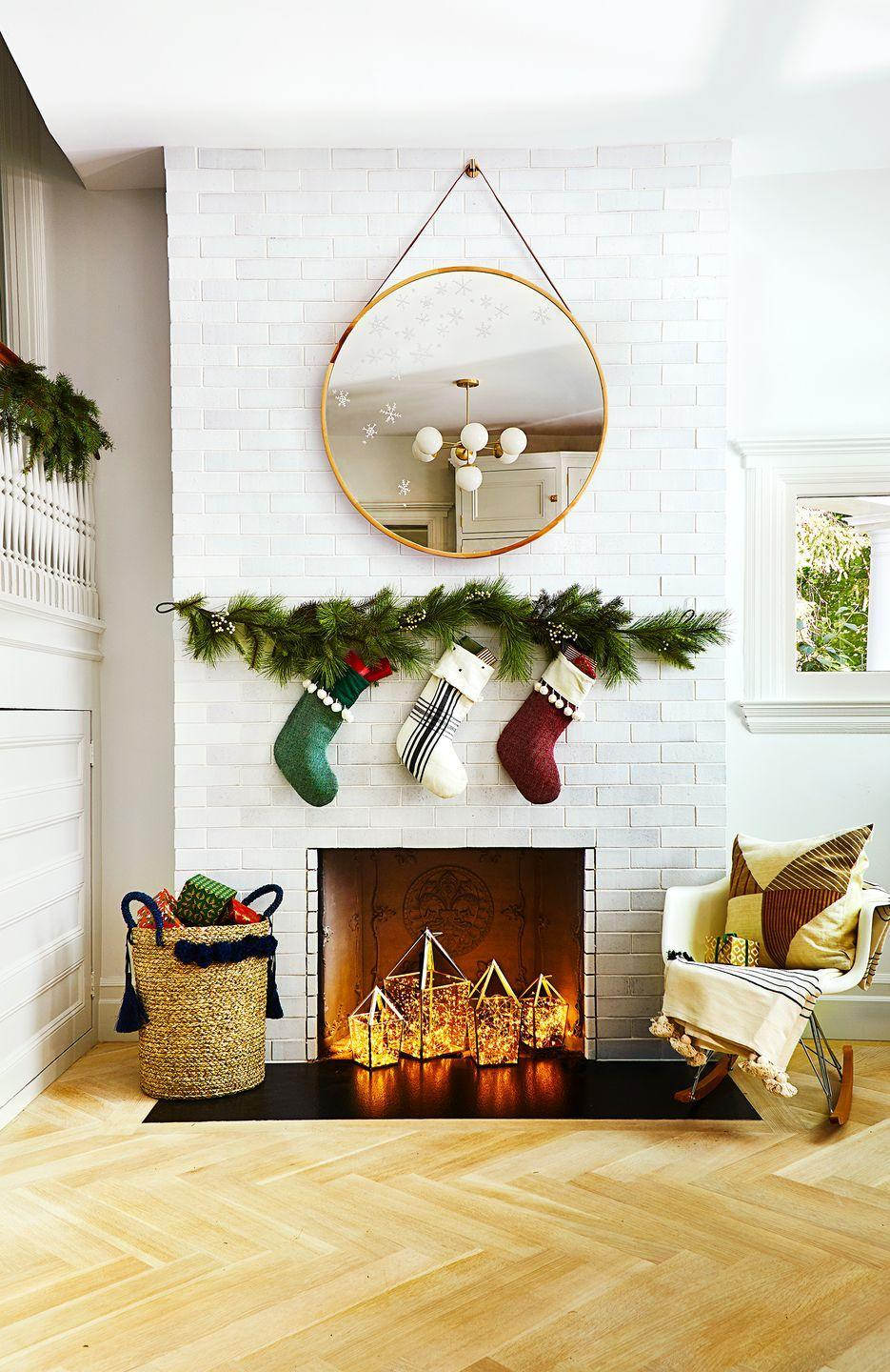 <p>Instead of putting candles in your lanterns, fill them with string lights. It's a great idea to make a non-working fireplace feel cozy. <br>And you can set this scene in five minutes flat. </p>
