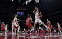 China's Yueru Li (14) grabs a rebound over Belgium's Marjorie Carpreaux (9) and Hanne Mestdagh (22) during a women's basketball game at the 2020 Summer Olympics, Monday, Aug. 2, 2021, in Saitama, Japan. (AP Photo/Eric Gay)