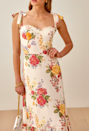 """A wedding is a wonderful reason to throw on a sweetheart neckline and shoulder bows, don't you think? $248, Nordstrom. <a href=""""https://www.nordstrom.com/s/reformation-nikita-midi-dress/5102541"""" rel=""""nofollow noopener"""" target=""""_blank"""" data-ylk=""""slk:Get it now!"""" class=""""link rapid-noclick-resp"""">Get it now!</a>"""