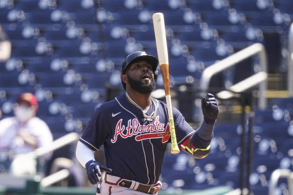 Atlanta Braves' Marcell Ozuna reacts after striking out during the fourth inning of the first baseball game of a doubleheader against the Washington Nationals at Nationals Park, Wednesday, April 7, 2021, in Washington. (AP Photo/Alex Brandon)
