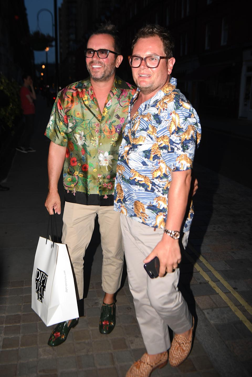 Alan Carr and partner Paul Drayton (left) arriving at Chiltern Firehouse in London to celebrate Kylie Minogue's 50th birthday.