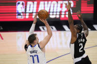 Dallas Mavericks guard Luka Doncic, left, shoots as Los Angeles Clippers forward Kawhi Leonard defends during the first half in Game 5 of an NBA basketball first-round playoff series Wednesday, June 2, 2021, in Los Angeles. (AP Photo/Mark J. Terrill)