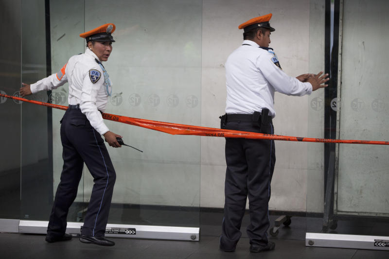 Airport police officers block the entrance where a shooting took place in Mexico City's international airport on Monday, June 25, 2012. Two people were shot to death and one was wounded at one of the airport's terminal and according to the federal Public Safety Department, at least one was a Federal Police officer. Details of the shooting are still unclear. (AP Photo/Alexandre Meneghini)