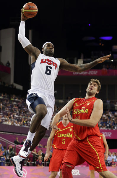 FILE - In this Aug. 12, 2012, file photo, United States' LeBron James dunks over Spain's Sergio Llull during the men's gold medal basketball game at the 2012 Summer Olympics in London. With USA Basketball and 2K Sports forming a partnership, fans can see what happens when the 1992 Dream Team goes up against this year's Olympic gold medal winner once NBA 2K13 hits the shelves this fall. (AP Photo/Eric Gay, File)