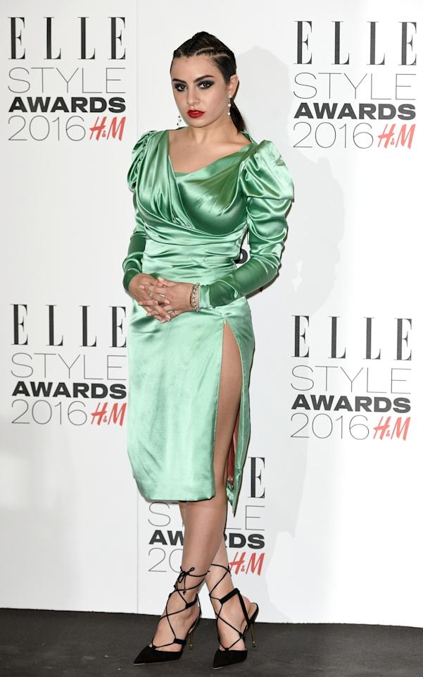 <p>Charli XCX's puffy shoulders were wild, and her dangerously high side slit was even crazier. (<i>Photo: Getty Images) </i></p>