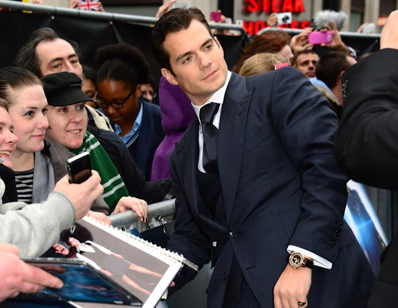 Actor Henry Cavill signs autographs for fans at the European Premiere of 'Man Of Steel' in London on Wednesday, June 12, 2013. (Photo by Jon Furniss/Invision/AP)