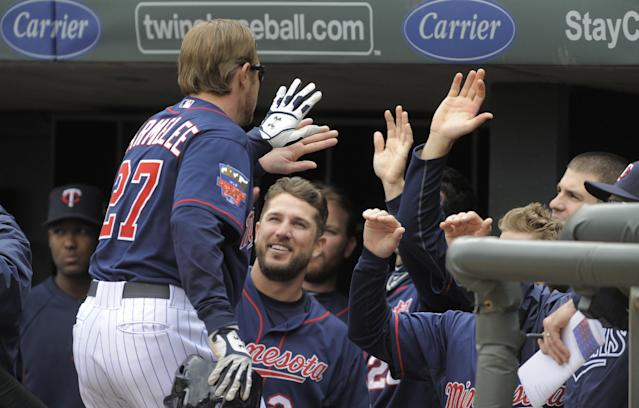 Minnesota Twins' Chris Parmelee gets congratulated in the dugout after hitting a two-run home run during the second inning of a baseball game against the Boston Red Sox, in Minneapolis, Thursday, May 15, 2014. (AP Photo/Tom Olmscheid)
