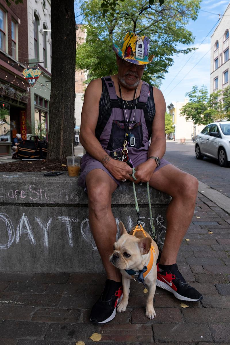 Ronald McLeish Lee, 68, is photographed in the Oregon District in Dayton, Ohio, on Saturday, Aug. 10, 2019, with his French bulldog.