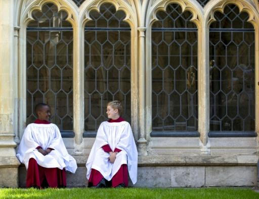 Members of St. George's Chapel Choir, nine year-old Nathan Mcharo (L) and eleven year-old Leo Mills sit outside prior to a rehearsal in Windsor