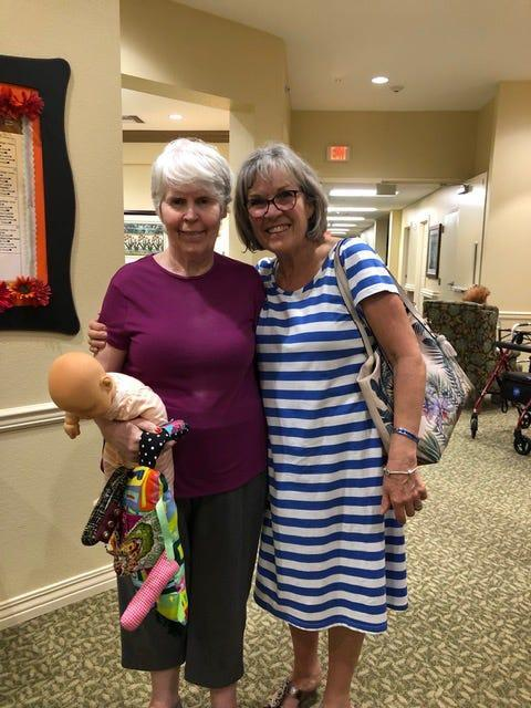 Margaret Taggart, left, and her sister Claire Harrison at Legend of Mansfield. Harrison said that Legend Senior Living charged her more than $2,000 in added fees after Taggart tested positive for COVID-19 in April.