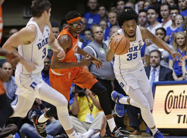 Duke's Marvin Bagley III (35) dribbles while Syracuse's Paschal Chukwu chases with Duke's Grayson Allen (3) during the first half of an NCAA college basketball game in Durham, N.C., Saturday, Feb. 24, 2018. (AP Photo/Gerry Broome)