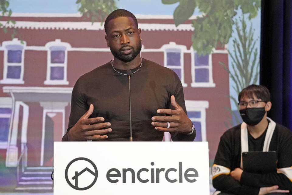 NBA All-Star Dwyane Wade speaks during a news conference Wednesday, Oct. 13, 2021, in Salt Lake City. Apple CEO Tim Cook and Wade joined Utah leaders to announce the completion of a local advocacy group's campaign to build eight new homes for LGBTQ youth in the U.S. West. (AP Photo/Rick Bowmer)