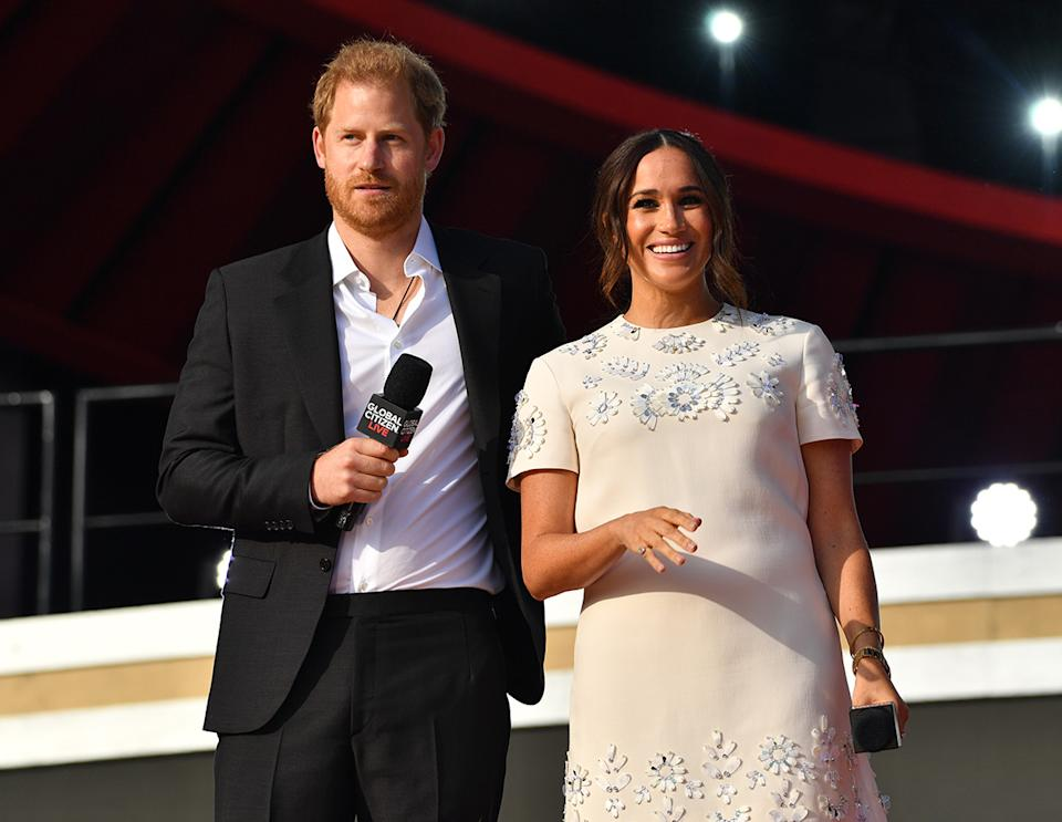 Prince Harry and Meghan Markle on stage