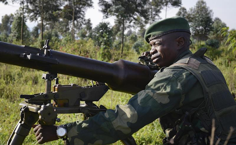 A Congolese army soldier aims artillery towards Kibumba Hill, which is occupied by M23 rebels, around 25kms from the provincial capital Goma, in eastern Congo Sunday, Oct. 27, 2013. The Congolese army says it has taken two more towns in the North Kivu province of eastern Congo in fresh fighting around Kibumba town using tanks and heavy artillery against the M23 rebels. (AP Photo/Joseph Kay)