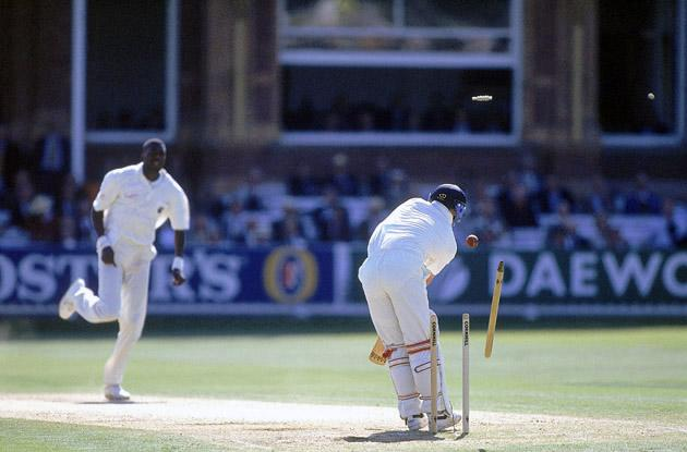 22 Jun 1995:  Curtly Ambrose of the West Indies bowls Darren Gough of England during the Second Test match at Lords in London. \ Mandatory Credit: Adrian Murrell /Allsport
