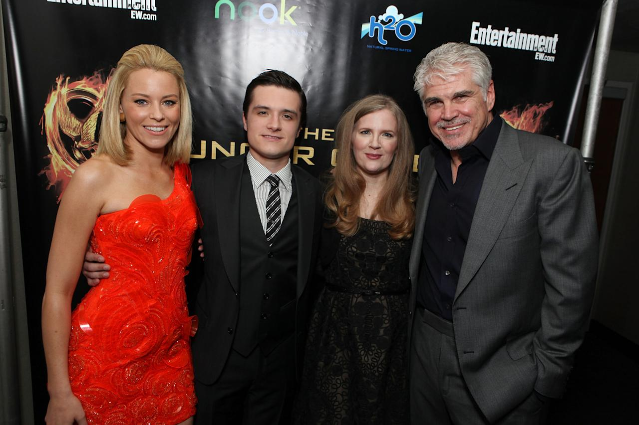 """Elizabeth Banks, Josh Hutcherson, Suzanne Collins and Gary Ross arrive at the world premiere of """"The Hunger Games"""" in Los Angeles, California."""