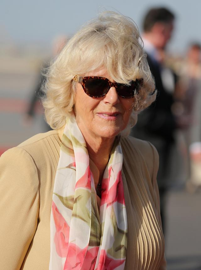 MUSCAT, OMAN - MARCH 17: Camilla, Duchess of Cornwall arrives at Oman International Airport on the seventh day of a tour of the Middle East on March 17, 2013 in Muscat, Oman. The Royal couple are on the fourth and final leg of a tour of the Middle East taking in Jordan, Qatar, Saudia Arabia and Oman. (Photo by Chris Jackson/Getty Images)