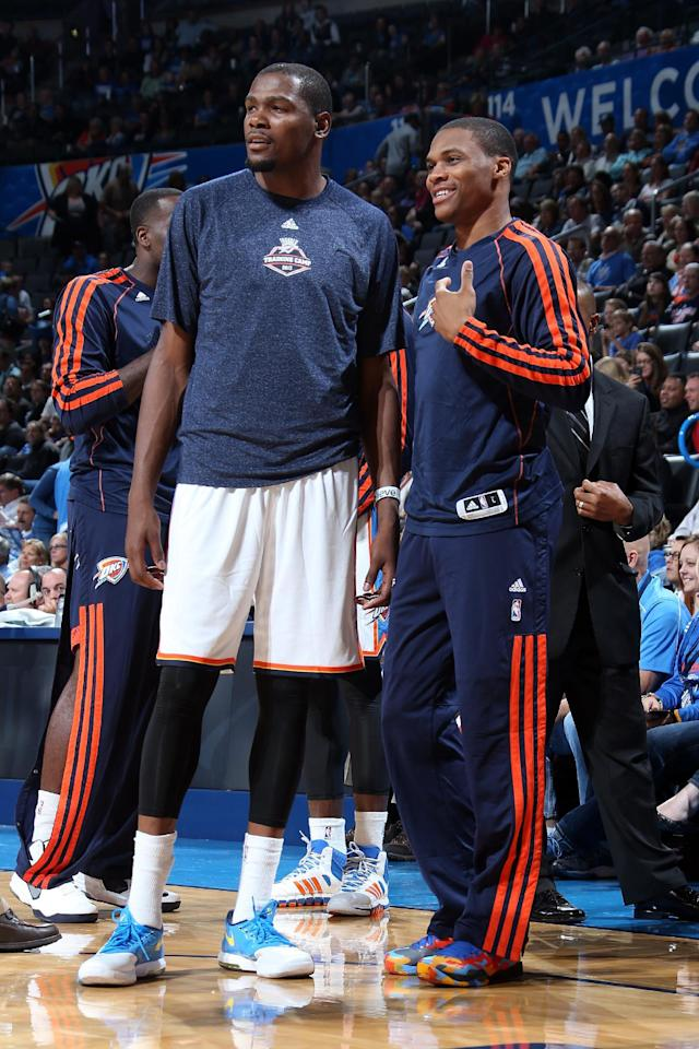 OKLAHOMA CITY, OK - OCTOBER 15: Kevin Durant #35 and Russell Westbrook #0 of the Oklahoma City Thunder smile during a preseason game against the Denver Nuggets on October 15, 2013 at the Chesapeake Energy Arena in Oklahoma City, Oklahoma. (Photo by Layne Murdoch/NBAE via Getty Images)
