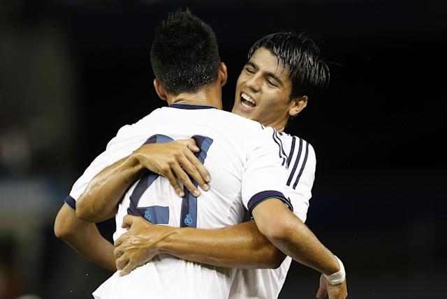 NEW YORK - AUGUST 08: Alvaro Morata #23 celebrates with Jose Maria Callejon #21 of Real Madrid during their match against A.C. Milan at Yankee Stadium on August 8, 2012 in New York City. (Photo by Jeff Zelevansky/Getty Images)