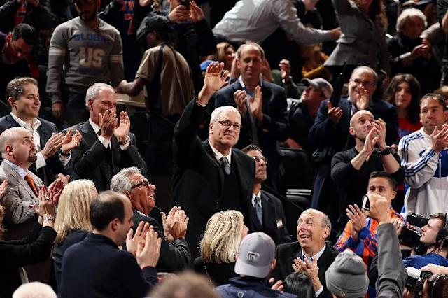 NEW YORK, NY - MARCH 19: Knicks legend Phil Jackson waves as he is welcomed back as President of the New York Knicks during a game against the indiana Pacers at Madison Square Garden in New York City on March 19, 2014. (Photo by Nathaniel S. Butler/NBAE via Getty Images)