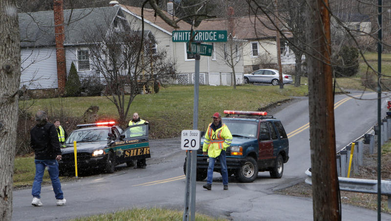 Emergency responders block Juniata Valley Road on Friday, Dec. 21, 2012 in Geeseytown, Pa. A man fatally shot a woman decorating for a children's Christmas party at a tiny church hall and killed two men elsewhere in the rural central Pennsylvania township Friday before he was fatally shot in a gunfight with state troopers.  (AP Photo/Keith Srakocic)