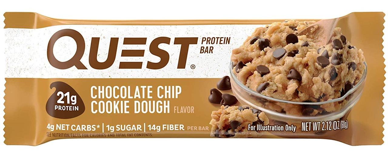 """<p>If you're on the go and need some energy, you can't go wrong with this <a href=""""https://www.popsugar.com/buy/Quest%20Nutrition%20Chocolate%20Chip%20Cookie%20Dough%20Protein%20Bar-470971?p_name=Quest%20Nutrition%20Chocolate%20Chip%20Cookie%20Dough%20Protein%20Bar&retailer=amazon.com&price=23&evar1=fit%3Aus&evar9=46407203&evar98=https%3A%2F%2Fwww.popsugar.com%2Ffitness%2Fphoto-gallery%2F46407203%2Fimage%2F46407206%2FQuest-Nutrition-Chocolate-Chip-Cookie-Dough-Protein-Bar&list1=shopping%2Camazon%2Chealthy%20snacks%2Csnacks%2Cprotein%20bars&prop13=api&pdata=1"""" rel=""""nofollow"""" data-shoppable-link=""""1"""" target=""""_blank"""" class=""""ga-track"""" data-ga-category=""""Related"""" data-ga-label=""""https://www.amazon.com/Quest-Nutrition-Protein-Chocolate-Packaging/dp/B00DLDH1N2/ref=sxin_3_osp20-2b500159_cov?ascsubtag=2b500159-eceb-4af4-b0ea-396e947c074c&amp;creativeASIN=B00DLDH1N2&amp;cv_ct_id=amzn1.osp.2b500159-eceb-4af4-b0ea-396e947c074c&amp;cv_ct_pg=search&amp;cv_ct_wn=osp-search&amp;keywords=protein%2Bbar&amp;linkCode=oas&amp;pd_rd_i=B00DLDH1N2&amp;pd_rd_r=299184b2-552d-47ba-be17-7eda33c5e8bc&amp;pd_rd_w=sqwf0&amp;pd_rd_wg=8uxuy&amp;pf_rd_p=c501273b-119a-4fc9-ad78-eda5006b0be9&amp;pf_rd_r=P9AZWJ002YBR9JVVW8N5&amp;qid=1563822854&amp;s=gateway&amp;tag=bestcont06-20&amp;th=1"""" data-ga-action=""""In-Line Links"""">Quest Nutrition Chocolate Chip Cookie Dough Protein Bar</a> ($23 for 12). They have plenty of flavors, but this is the one I always come back to. If you have the time, put it in the microwave for 20 seconds, and thank me later.</p>"""