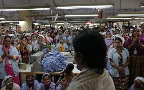 Huq speaks to the largely female workforce inside one of Mohammadi Group's garment factories - Credit: Susannah Savage/Tousif Farhad