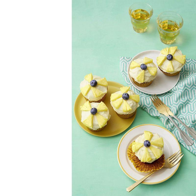 """<p>On Mother's Day, the basics aren't going to cut it. Skip the simple vanilla and chocolate cupcakes and go for something tropical with these banana, pineapple and blueberry delights.</p><p><em><a href=""""https://www.womansday.com/food-recipes/food-drinks/a19123934/hummingbird-cupcake-recipe/"""" rel=""""nofollow noopener"""" target=""""_blank"""" data-ylk=""""slk:Get the recipe for Hummingbird Cupcakes."""" class=""""link rapid-noclick-resp"""">Get the recipe for Hummingbird Cupcakes. </a></em></p>"""