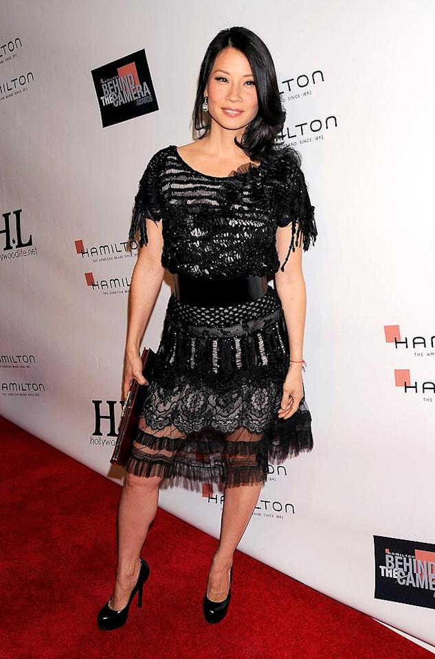 """Lucy Liu is quite possibly this week's best dressed woman thanks to her vintage tulle patchwork piece from Christian Lacroix's Haute Couture collection. Her YSL """"Trib Two"""" pumps, Gilan jewels, and Roger Vivier clutch complete the look. Gregg DeGuire/<a href=""""http://www.wireimage.com"""" target=""""new"""">WireImage.com</a> - November 9, 2008"""