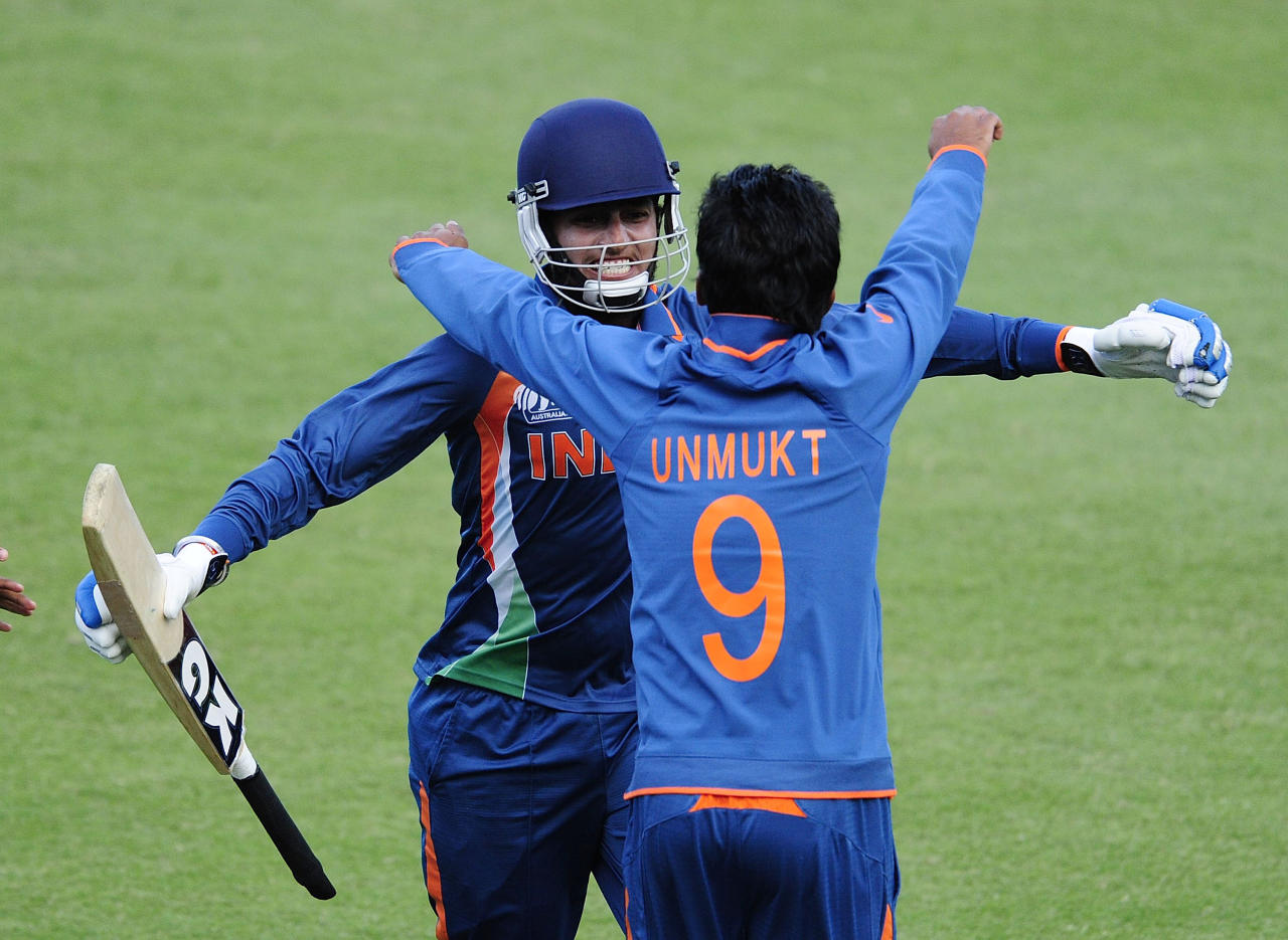 TOWNSVILLE, AUSTRALIA - AUGUST 20:  Harmeet Singh of India is embraced by Unmukt Chand of India  after scoring the winning runs during the ICC U19 Cricket World Cup 2012 Quarter Final match between India and Pakistan at Tony Ireland Stadium on August 20, 2012 in Townsville, Australia.  (Photo by Ian Hitchcock-ICC/Getty Images)
