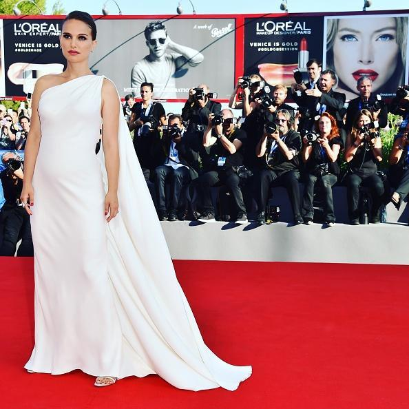 <p>Natalie Portman revealed she's expecting her second child at the 73rd Venice Film Festival in a elegant white dress. <i>[Photo: Getty]</i></p>