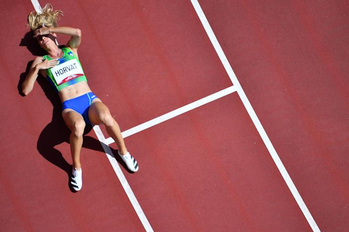 <p>An overview shows Slovenia's Anita Horvat reacting after competing in the women's 400m heats during the Tokyo 2020 Olympic Games at the Olympic Stadium in Tokyo on August 3, 2021. (Photo by Antonin THUILLIER / AFP)</p>