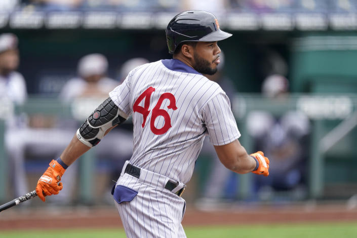 Detroit Tigers' Jeimer Candelario hits an RBI single during the first inning of a baseball game against the Kansas City Royals Sunday, May 23, 2021, in Kansas City, Mo. (AP Photo/Charlie Riedel)
